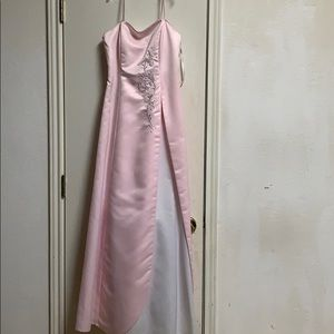 Pink dress with a splash of white .